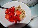 Scrumptious breakfast of fresh fruit, yoghurt and cereal