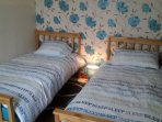 1 standard size twin bedroom with a freeview tv with a built in dvdplayer