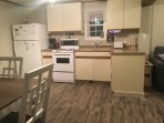 Fully equipped kitchen area.