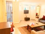 Enter into a large living space with three windows, television with Comcast xfinity cable and games.