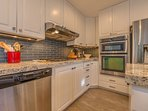 Upper level fully equipped kitchen with stainless steel appliances