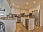 Upper level kitchen with large stainless refrigerator and fully equipped with great Chef's supplies (All-Clad, Henkel...