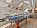 Loft game room with pool table that has ping pong top, 40' HD Smart Direct TV with 180 premium channels, Blue Ray DVD...