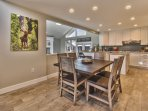 Fully equipped kitchen and dining area with seating for 6