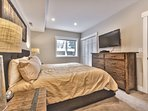 Lower level master suite with king bed, 42' HD TV/DVD, and full private bathroom
