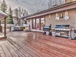 Spacious private deck with two stainless steel BBQ grills, hot tub and kids playhouse, and large back yard