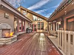 Spacious private deck with two stainless steel BBQ grills, hot tub and kids playhouse, and gas fireplace