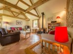 The lounge with cosy underfloor heating and a woodburner
