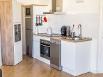FULLY EQUIPED KITCHEN WITH FRIDGE,MICROWAVE, OVEN,VITROCERAMIC HOBS,TOASTER, COFFEE MACHINE DISHWASH