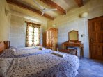 Single bedroom in a triple bed configuration