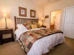 Master bedroom with king bed, attached bath, additional private vanity, walk-in closet and TV