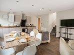 Open plan living/dining and kitchen area.