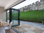 Bi- fold doors from the open dining area.