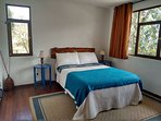 Bright double room with views of ruins and mountains.