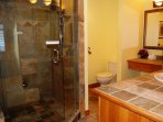 The walk-in shower is modern and clean