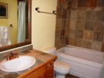 The bathroom features a shower and tub combination
