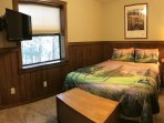 Golf Bedroom has a Queen Bed, Dish Satellite TV, and Free Wi-Fi