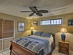 Retreat to the master bedroom to lay on the queen-sized bed.