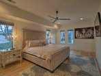 Enjoy peaceful slumbers on a plush king bed in the master bedroom.