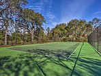Warm up with a morning game of tennis.