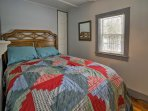 The master bedroom offers a full-sized bed.
