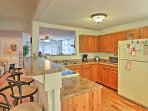 Utilize the updated appliances featured in the fully equipped kitchen.