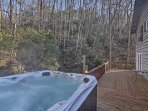 Ease sore muscles in the private hot tub on the deck!