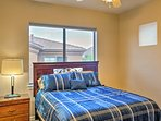 Bedroom four has a queen bed, mountain views, and a flat-screen cable TV.