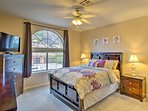 Bedroom two has a plush queen-sized bed, mountain views, and a flat-screen cable Smart TV.