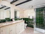 The ensuite bathroom contains a walk-in shower, toilet and double wash basin...