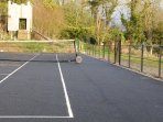 All-weather tennis court and play fort