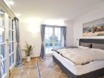 L'Esterel bedroom, with boxspring beds, wall integrated aircon, direct garden access private bath