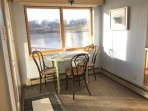Breakfast nook with sliding glass doors out to deck
