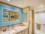 After a day at the beach, relax in the spa-like bathroom with a large  walk-in shower.