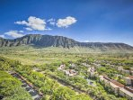 The condo offers stunning views of the mountains, valley, ocean, and lush greenery.