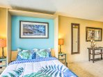 Enjoy a comfortable rest on this queen bed after each beach-filled day.