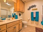 This second bathroom is complete with a spacious vanity.