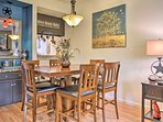 Gather around this 6-person dining table for dinner.