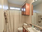 Wash up in the second full bathroom, equipped with a shower/tub combo and single vanity.