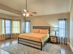 Enjoy a great night's sleep on the cozy king-sized bed in the master bedroom.