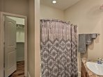 Utilize the shower/tub combo, single vanity and large walk-in closet featured in the master en-suite.