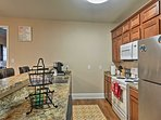 The kitchen is fully equipped with updated appliances and large granite countertops.