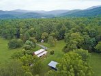 Our farmhouse, nestled at the foot of the Shenandoah National Park.