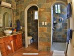 The large master bath offers you privacy while showcasing beautiful local stone.