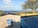 Step outside the master bedroom to enjoy your coffee poolside.