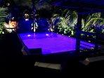 Pool Side Lounge Seating at Night