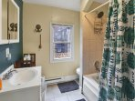 Full modern bathroom with wide shower head, plenty of water pressure for great showers, clean