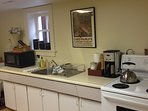 Large Kitchen with full size appliances, range, fridge, microwave and coffee maker