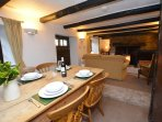 Lounge/dining room with feature beams
