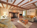 Spacious lounge with woodburner and doors to patio area